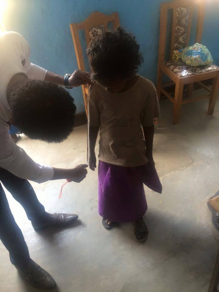 Orphans supported by Miss Africa USA get measurements for New School Uniforms.