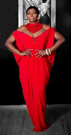 Uche in red dress